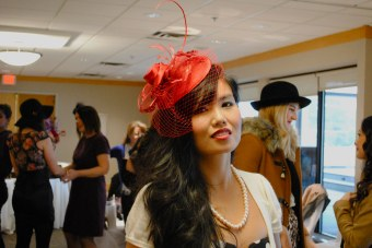 Aurora in a red hot fascinator from Anastacia Shorohov, designer of Drama Queen