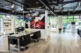 Pops of colour punctuate the minimalist salon space