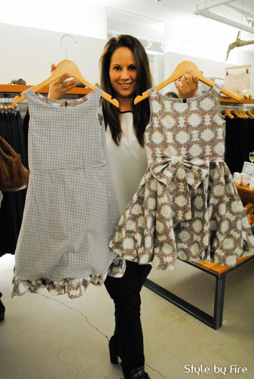 Jessica Walker, Wholesale Manager of Redfish kids, holding up the double sided bubble dress